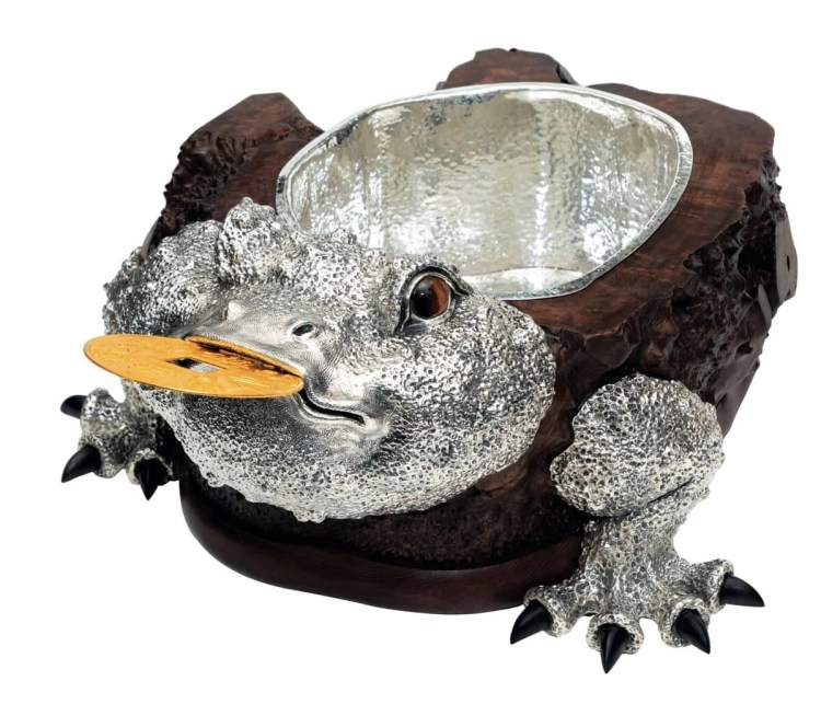 adf-web-magazine-3. lucky toad bucket with a coin