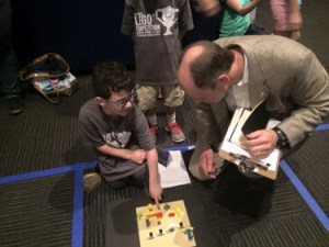 Explaining his Lego competition entry to the judge
