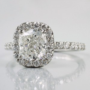 A cushion cut diamond halo engagement ring customized .from Adiamor