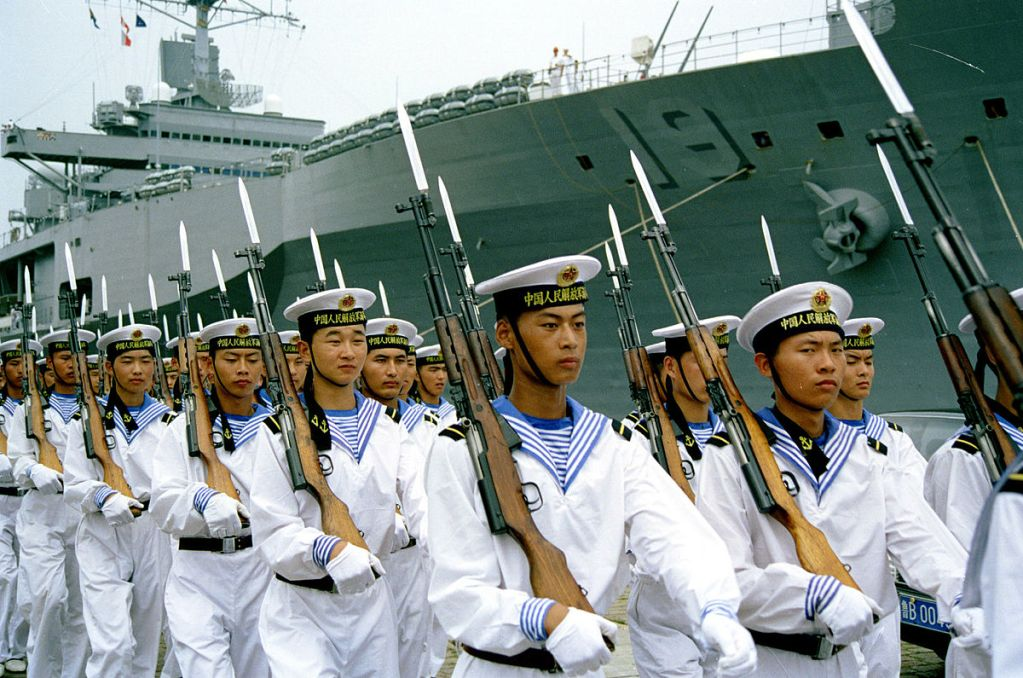People's Liberation Army Navy sailors at the Qingdao, North Sea Fleet headquarters parading in 2000 for a visiting U.S. Navy delegation.