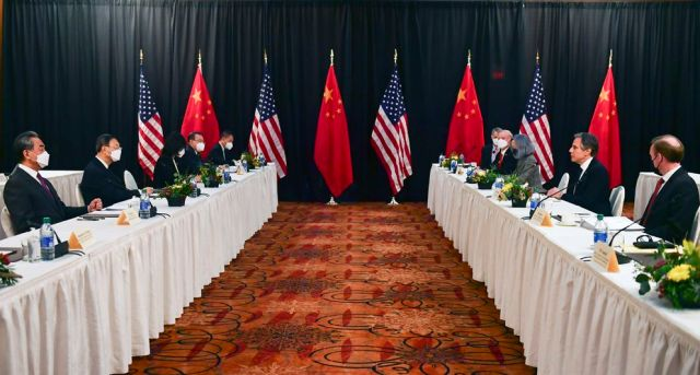 Secretary of State Antony Blinken, second from right, joined by national security adviser Jake Sullivan, right, speaks while facing Chinese Communist Party foreign affairs chief Yang Jiechi, second from left, and China's State Councilor Wang Yi, left, at the opening session of US-China talks at the Hotel Captain Cook in Anchorage, Thursday, March 18, 2021. (Frederic J. Brown/Pool via AP)
