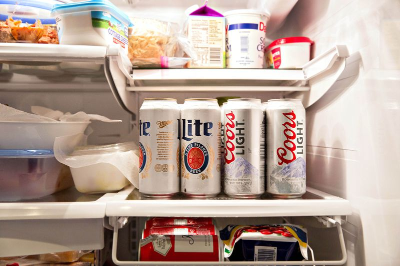 Cans of Molson Coors Brewing Miller Lite and Coors Light brand beer are arranged for a photograph in a refrigerator in Princeton, Illinois, on Oct. 26, 2016. Daniel Acker/Bloomberg