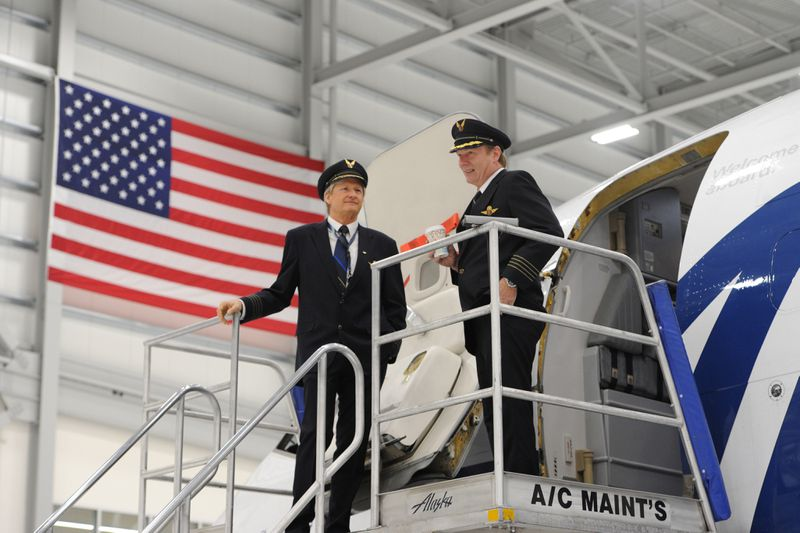 Alaska Airline captains Mark Calkins and Sean Ellis were on hand for the opening of the 100,000-square-foot Maintenance and Engineering Facility and Hangar. (Bill Roth / ADN)