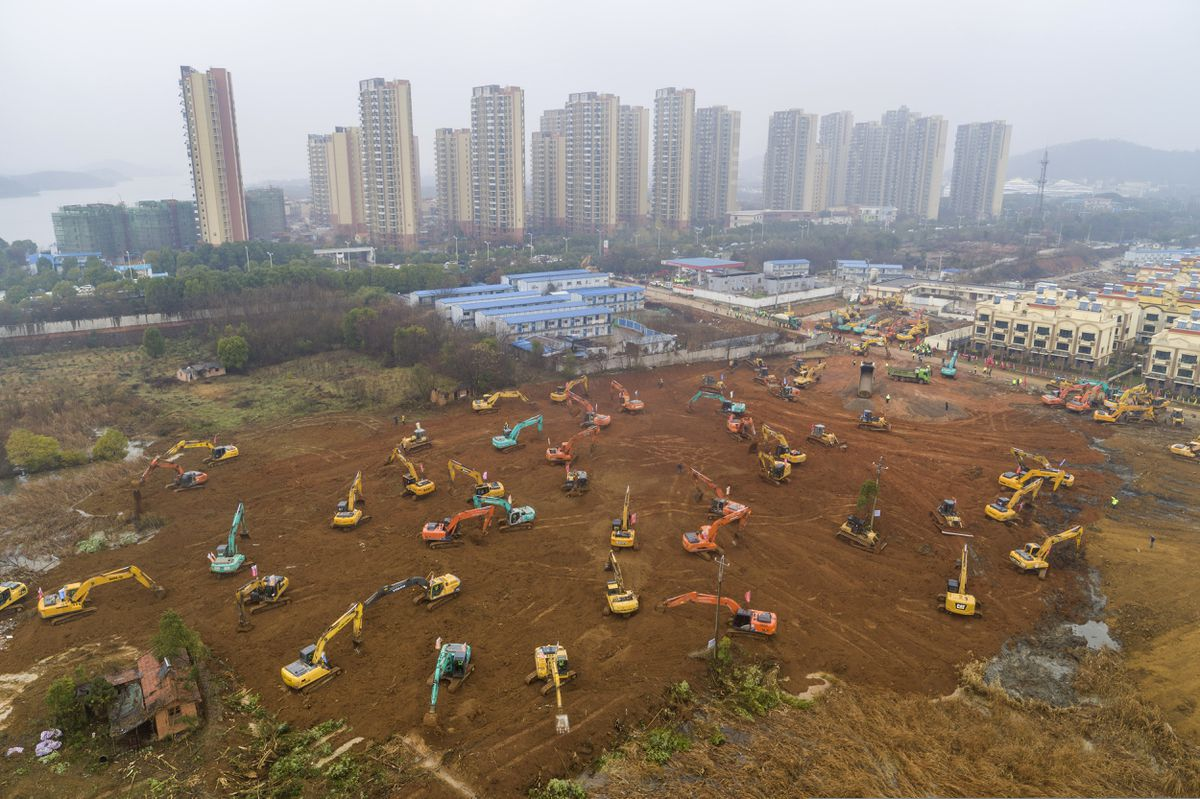 China expands city lockdown, fast-tracks hospital building in ...