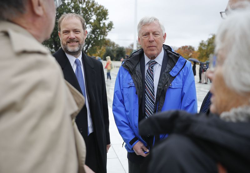 Alaska resident John Sturgeon, right, and his attorney, Matthew Findley, left, outside the Supreme Court in Washington, Monday, Nov. 5, 2018. Sturgeon sued the Park Service in 2011 after it told him to stop operating his hovercraft on stretch of the Nation river that passes through the federally created preserve. The State of Alaska would permit this, but the National Park Services regulations said he could not. (AP Photo/Pablo Martinez Monsivais)