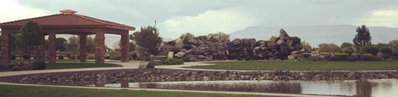 cloudy skies over pond-Adobe Falls Subdivision in Fruita