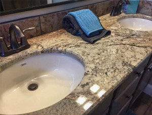 Granite counters on guest vanity of 1327 Eagle Way
