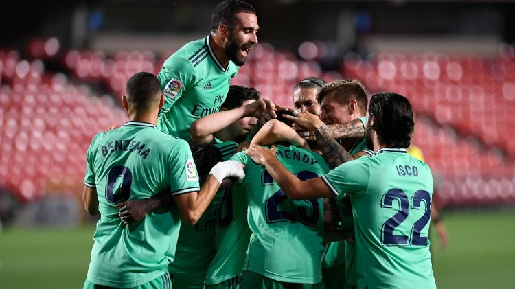 Real Madrid edge towards La Liga title with nervy win at ...