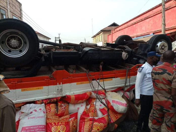 Two injured after truck rams into six cars, shop 8