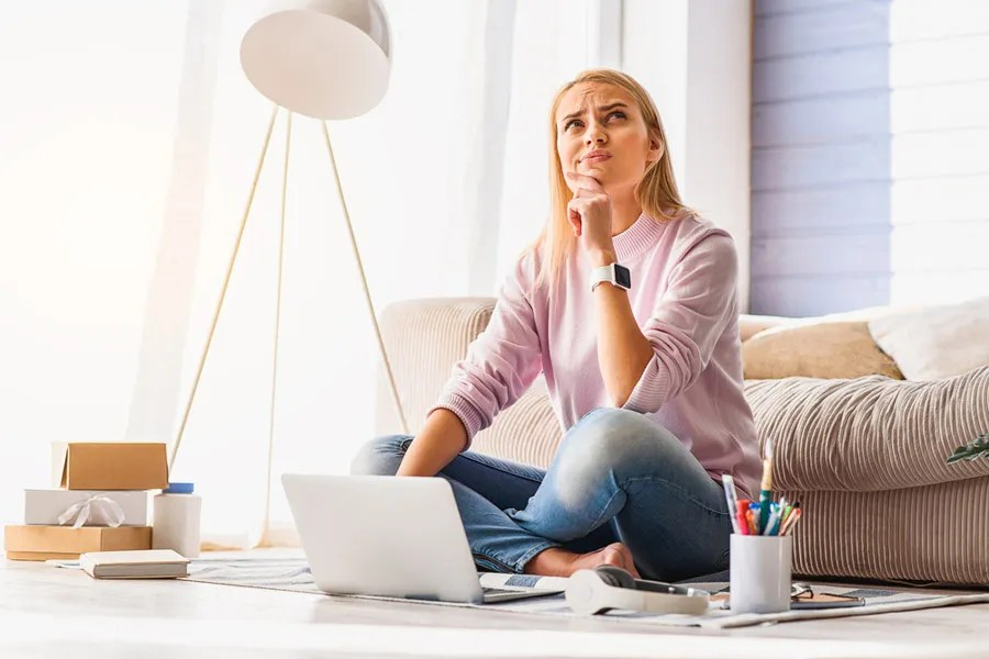 Woman thinking of ideas for her YouTube channel
