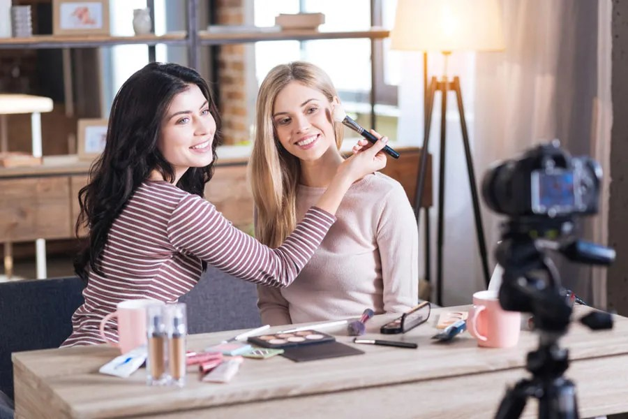 Two women filming a video for YouTube