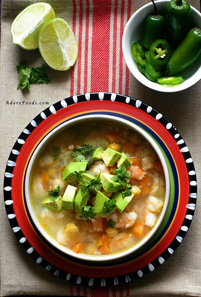 Mexican Seafood Soup - tender shrimp pieces, carrots and beans in a spicy smoky adobo broth. This authentic Mexican soup is on the table in 30 minutes. #mexican