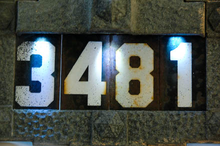 Address number sign remounted with hood.