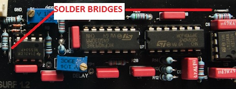 Reuse clipped leads from other components for the solder bridges
