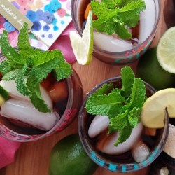 Cuba Libre, a Cuban cocktail with rum, lime, and mint