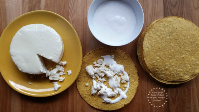 Making tostadas with cream and crumbled queso fresco as a side for the chicken pozole #ABRecipes #TASTE15