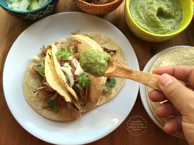 Garnish the tacos with spicy serrano guacamole sauce #Porknostico #ad