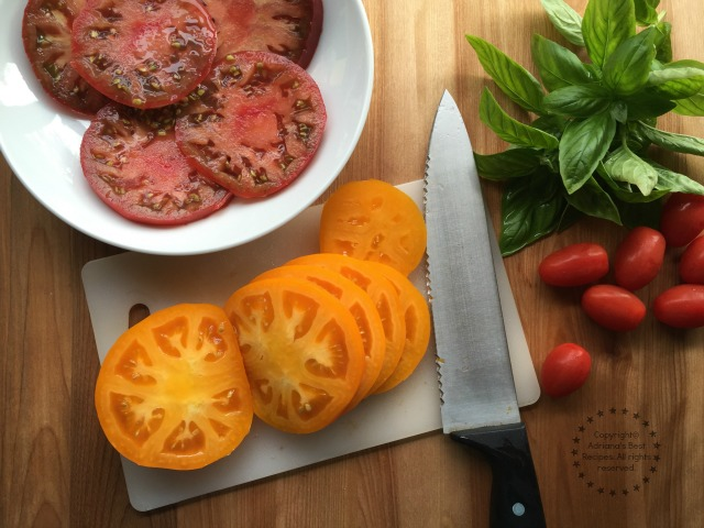 Slicing the tomatoes for the Heirloom Tomato and Burrata Salad
