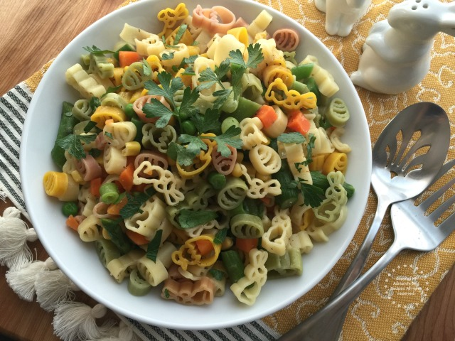 The spring pasta goes perfect with parmesan cheese too