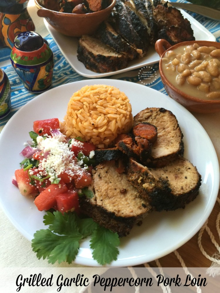 Grilled Garlic Peppercorn Pork Loin paired with Mexican rice, chorizo, grilled watermelon salsa and mayocoba beans