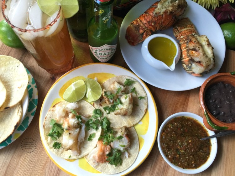 A lobster taco feast paired with a refreshing michelada