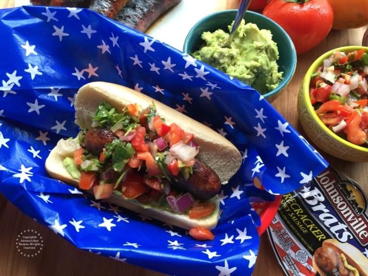 Garnish the Spicy Firecracker Pork Brats with pico de gallo and enjoy