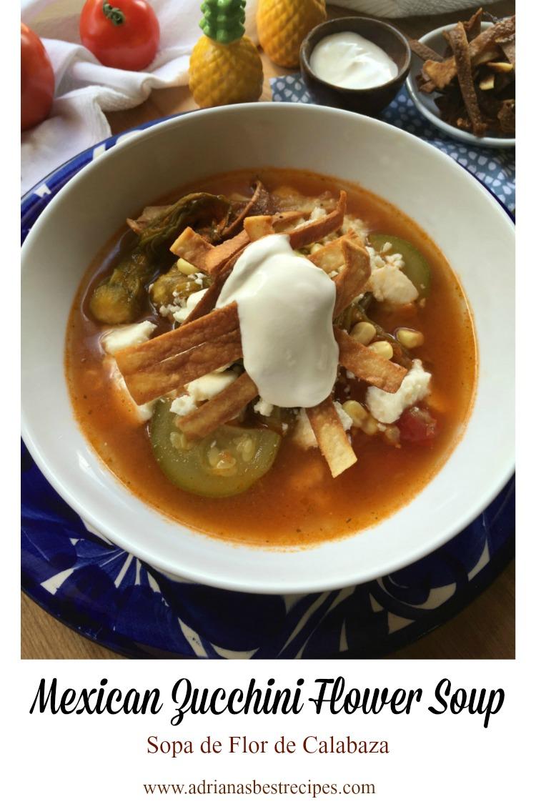 Sopa de flor de calabaza hecha con calabacines, flores de calabaza, granos de elote y tomates frescos. Servida caliente acompañada con crema mexicana y tiras de tortilla frita.