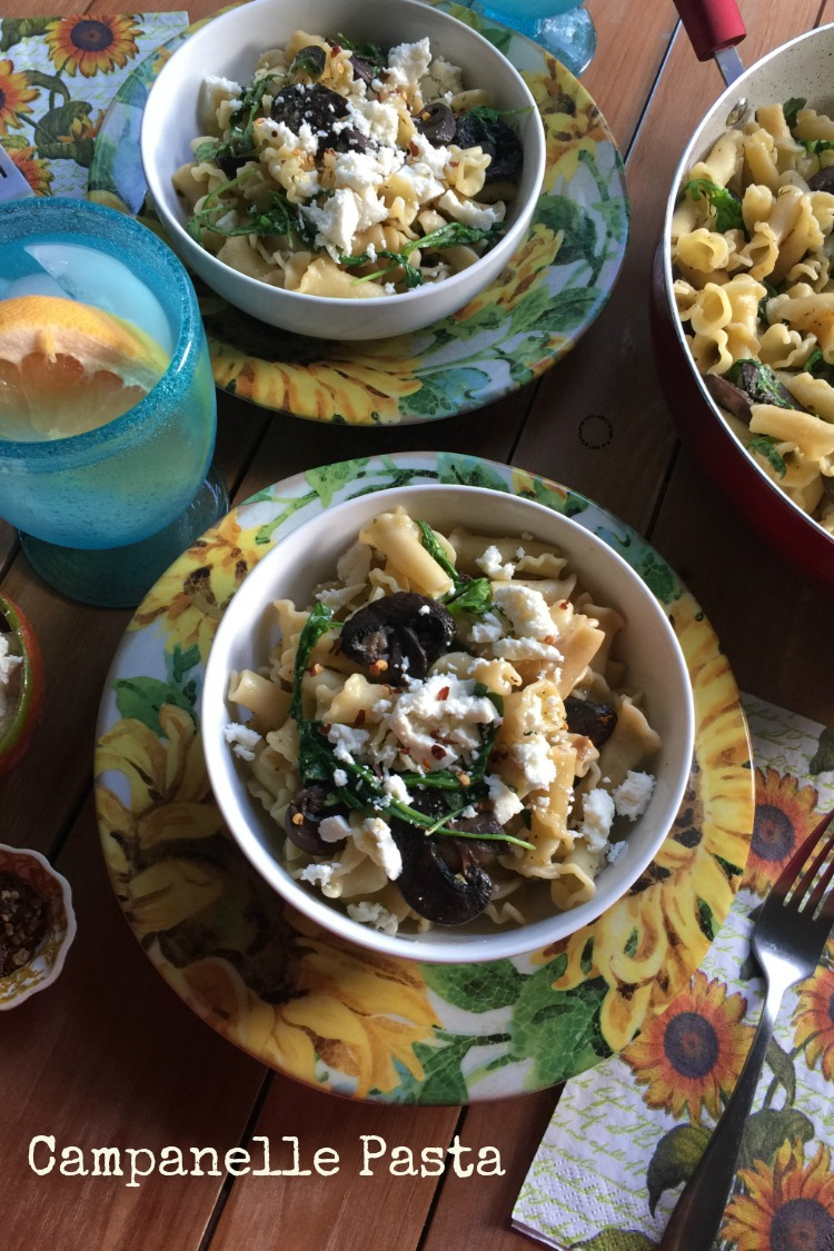 Simple Campanelle Pasta with mushrooms, arugula, serrano peppers and garlic. Then garnished with crumbled queso fresco and red pepper.