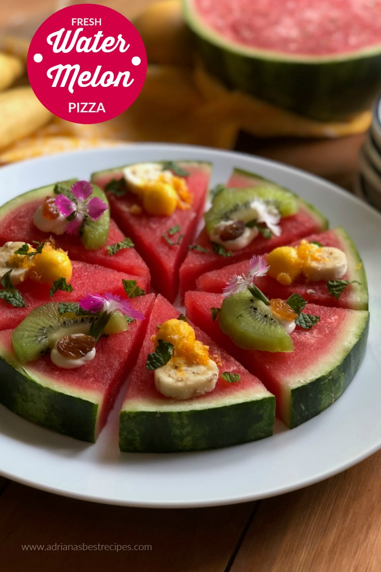 Let the pizza party start making a fresh watermelon pizza, made with a sweet petite watermelon round thick slice, soft cream cheese, green kiwi fruit, champagne mango pearls, Manzano banana rounds, fresh mint, golden raisins, tangerine crisps and edible carnation flowers.