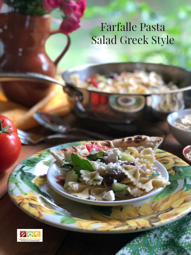 The farfalle pasta salad Greek style is a perfect starter to a family dinner. This recipe is made with mini farfalle pasta, cherry tomatoes, purple onions, seedless cucumber, purple onions, feta cheese crumbles, fresh parsley, kalamata olives, lemon juice, olive oil and Greek seasoning with black pepper, dried basil, oregano, thyme, marjoram, garlic powder and salt to taste.  #LagostinaUSA #LagostinaSundayDinner - AD