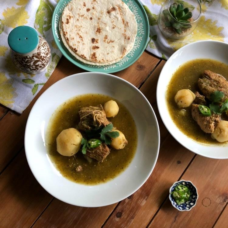 Serve the Instant Pot Salsa Verde Pork Stew with a side of warm flour tortillas