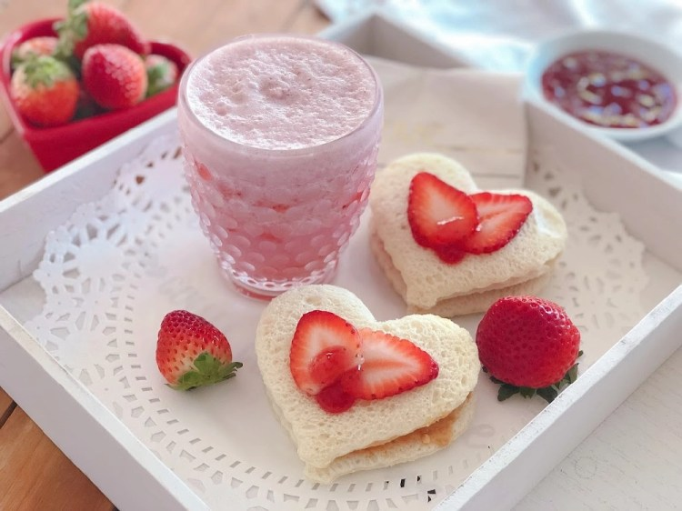 Serving the strawberry jam sandwich hearts with a milkshake