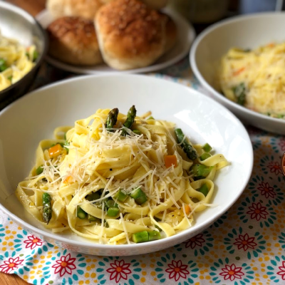 This recipe for the homestyle fettuccine has asparagus, garlic, preserved lemons, and freshly shredded Parmesan cheese.