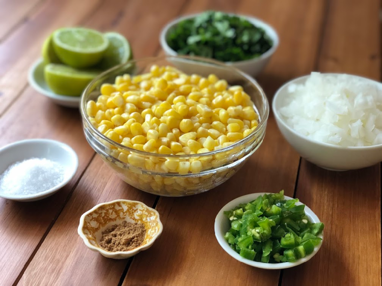 The ingredients for making the salsa include sweet corn, jalapeño peppers, white onion, cilantro, lime juice, cumin, and salt.