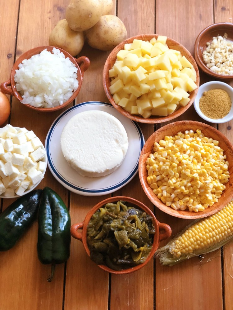 The ingredients for the soup include potatoes, corn, onion, garlic, queso fresco, roasted poblanos, milk, and seasonings
