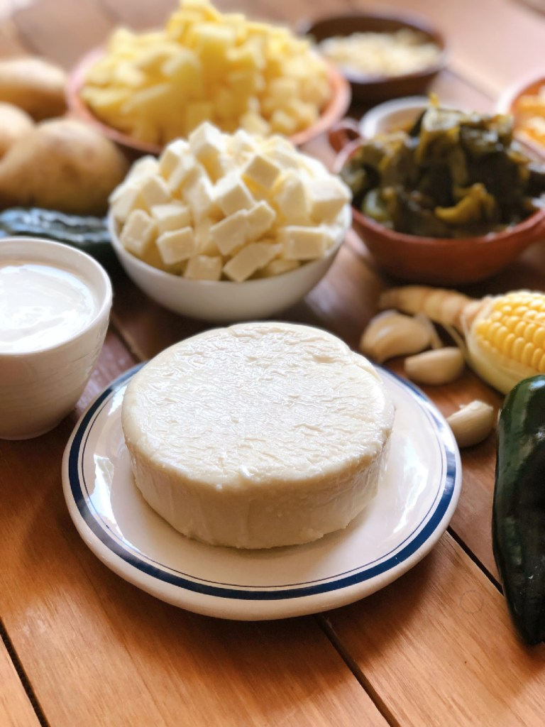 A round of queso fresco cheese and Mexican crema
