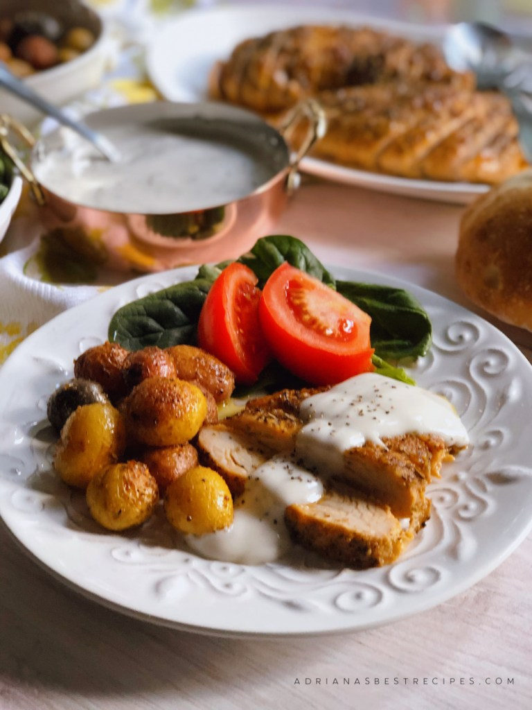 Thanksgiving dinner is served we are having delicious turkey tenderloin with peppered gravy, roasted potatoes and a spinach tomato salad.