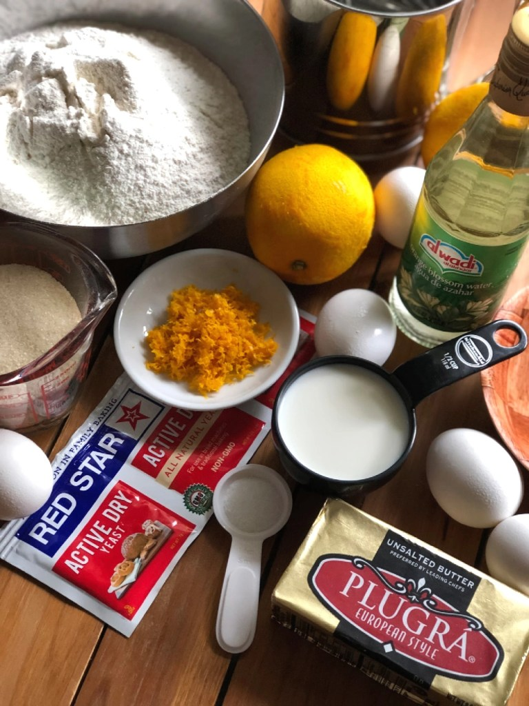 Ingredients for making pan de muerto inlcude sifted flour, eggs, yeast, orange peel, sugar, butter, and orange blossom water.
