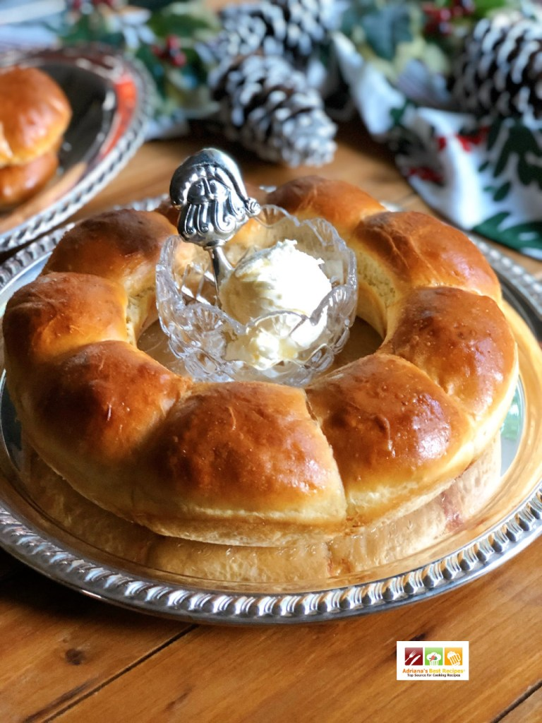 An edible bread wreath for the holidays served on a silver tray and paired with whipped butter