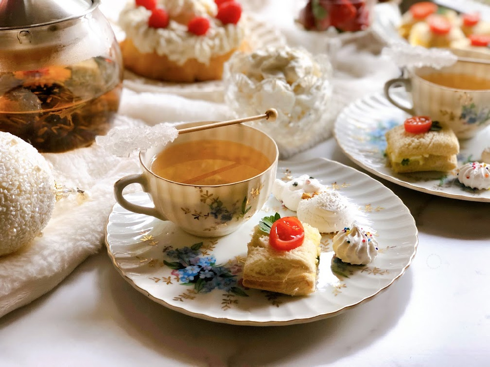 High Tea Party Downton Abbey Style with egg sandwiches, floral tea, and meringues