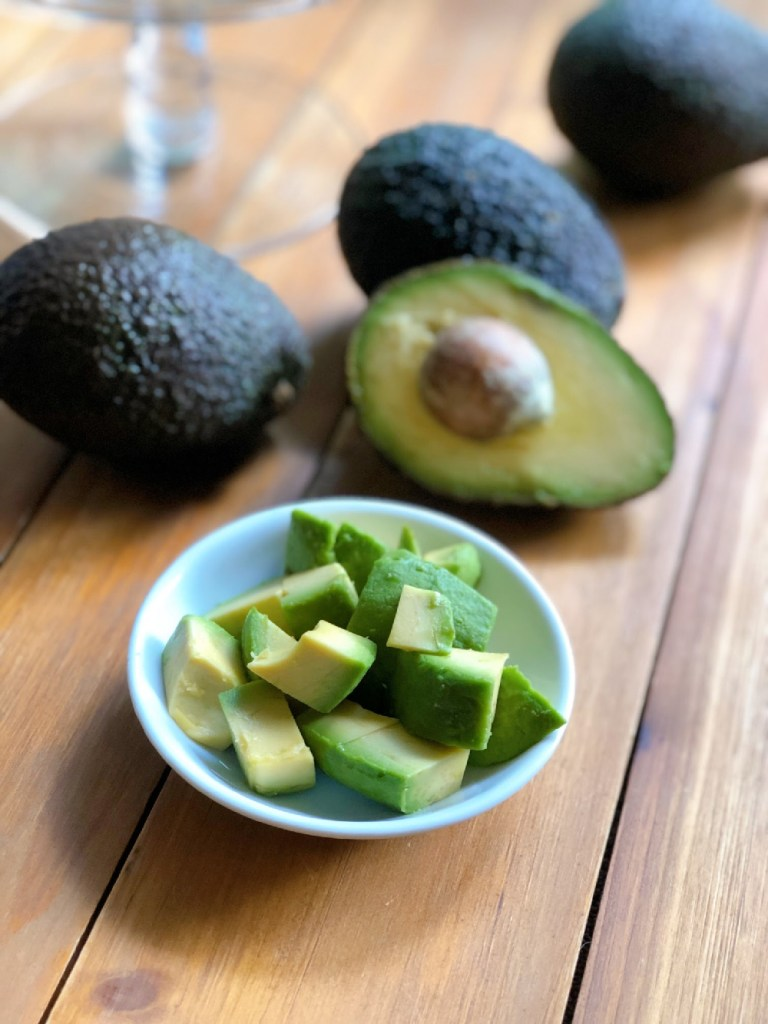 Avocados are a heart-healthy option. We slice first and then cut cubes.