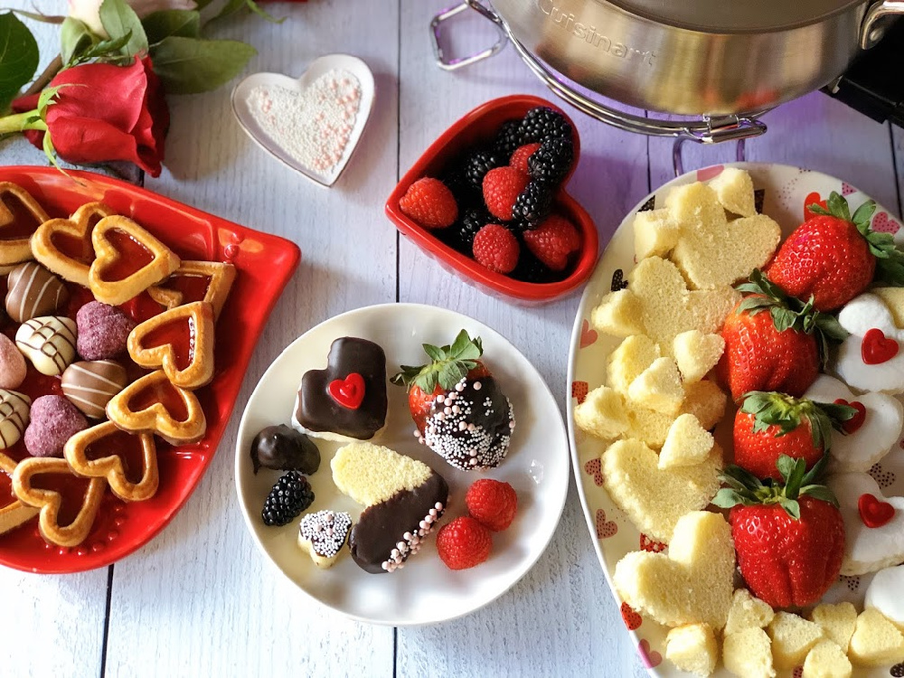This is the Chocolate Fondue Party for Chocolate Month. It has a plate with cake hearts, marshmallows, and assorted berries.