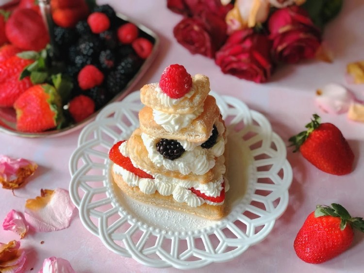 Mixed Berries Mille-Feuille or Napoleon served on a white plate