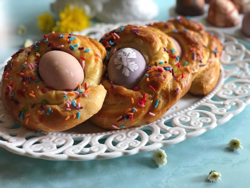 European Easter bread with naturally colored Easter Eggs and sprinkles