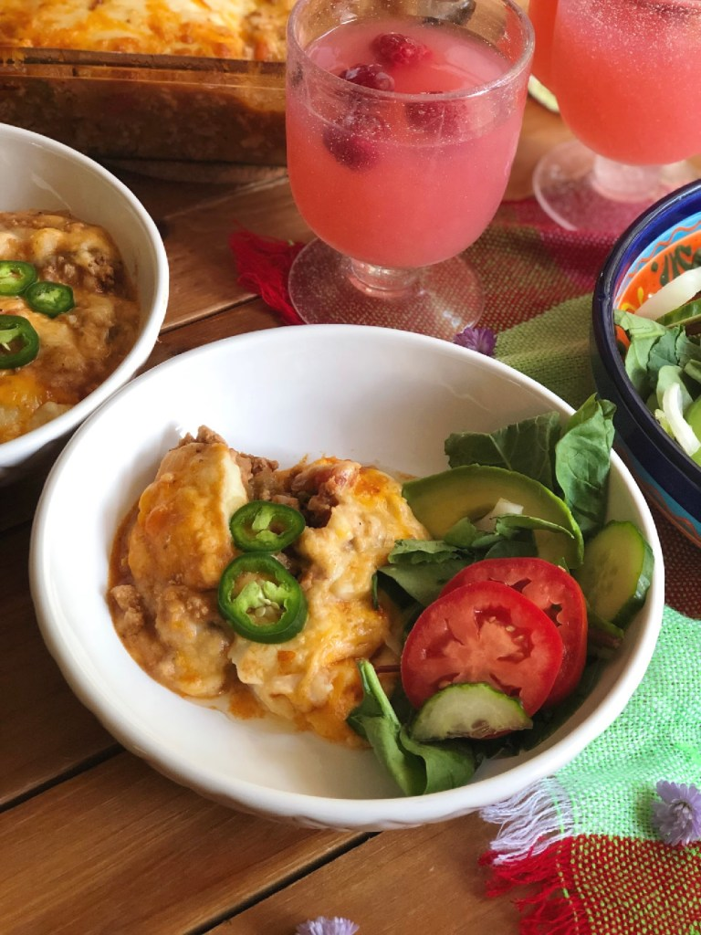 Serving the meal with a fresh salad and raspberry lemonade agua fresca