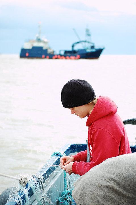 Mending net on the boat