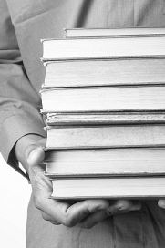 Man holding stack of books 2