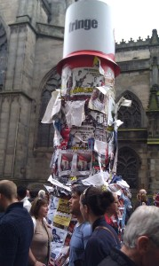 A pillar with lots of flyers stuck to it