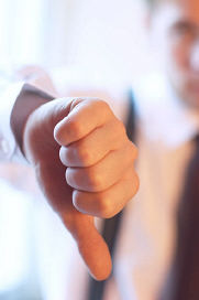 Man giving thumbs down signal