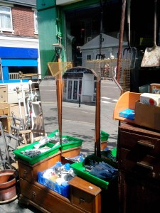 Picture of a jam-packed shop with lots of furniture outside